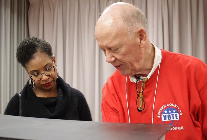 Robin Dupoux gets her voting instructions at Volunteer State Community College in Gallatin, TN on Tuesday, November 6, 2018.