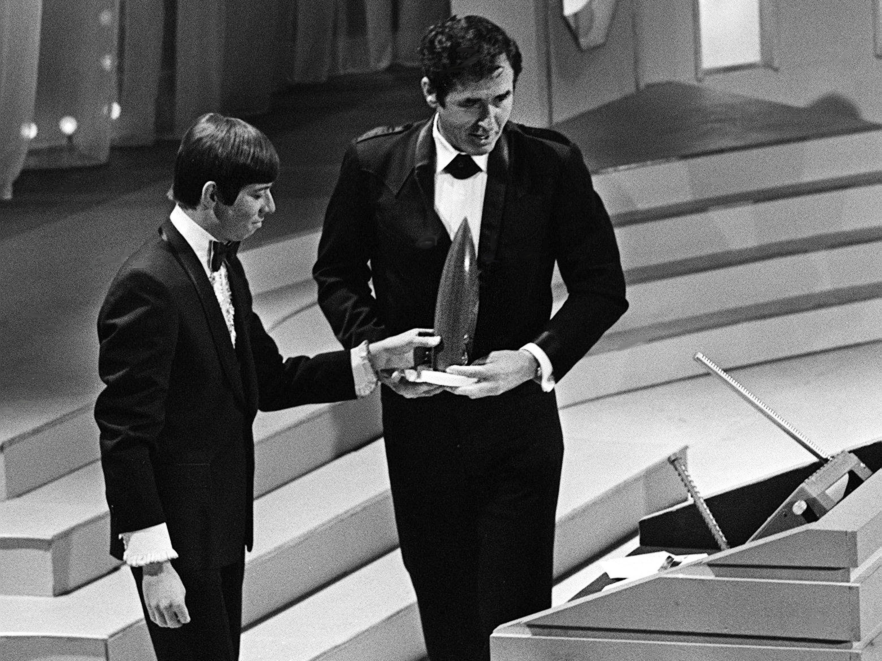Sheb Wooley, also known as Ben Colder, right, accepts his Comedian of the Year award from presenter Bobby Goldsboro during the second annual CMA Awards show at the Ryman Auditorium on Oct. 18, 1968.