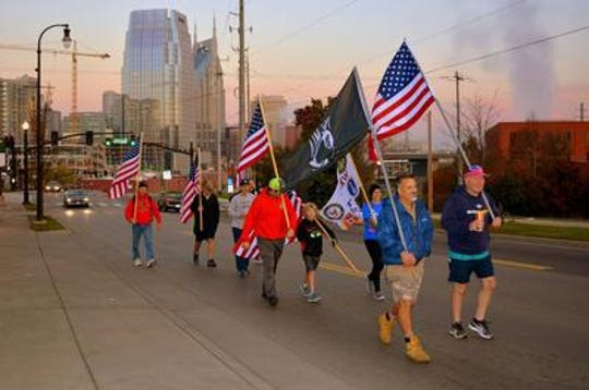 Jim Retzke, front left, leads the 32-mile Fallen Soldiers March each Veterans Day from downtown Nashville to Wilson County.