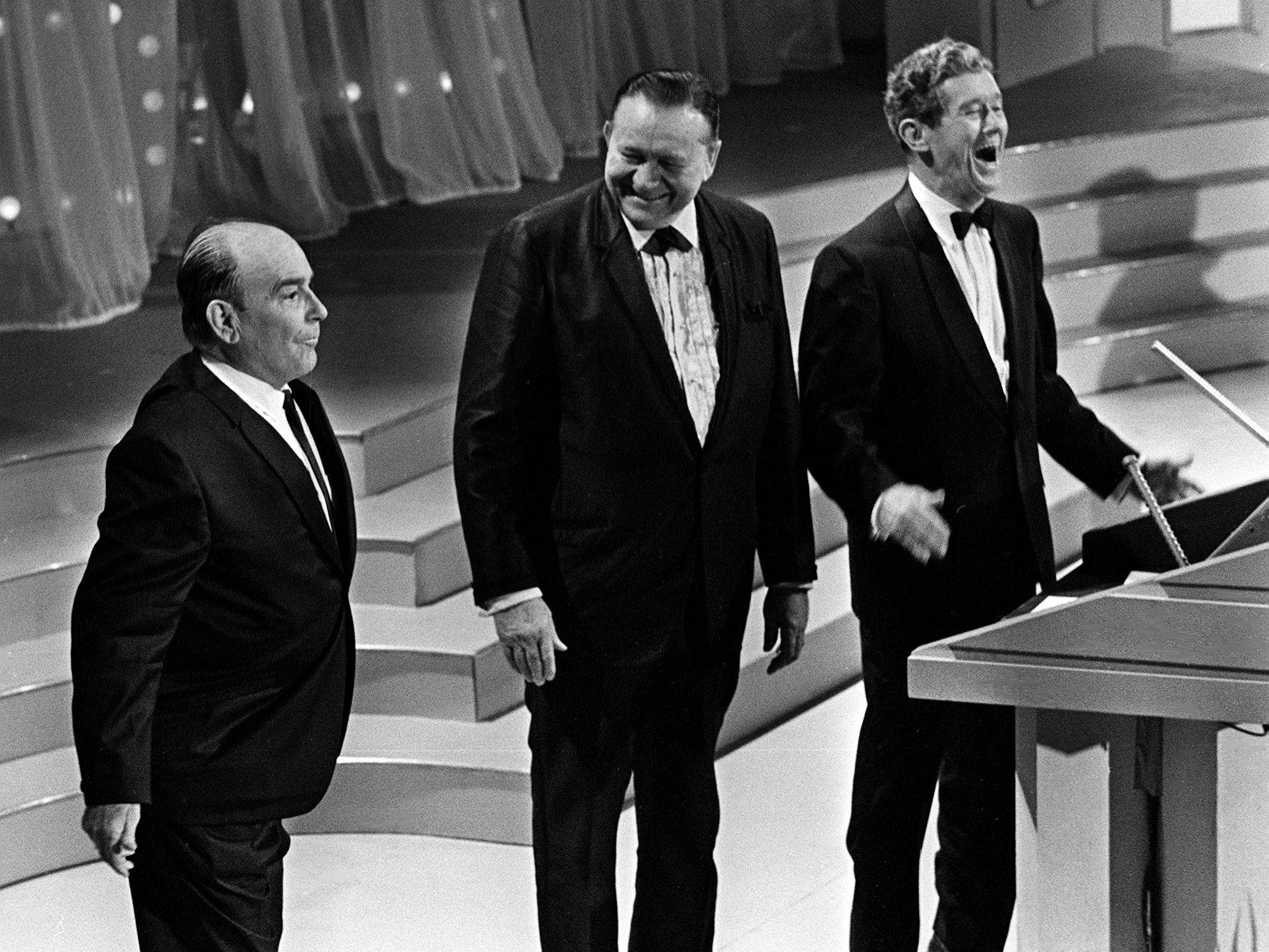 """""""Texas Playboy"""" Bob Wills, left, writer of """"San Antonio Rose,"""" is named to the Country Music Hall of Fame during the second annual CMA Awards show at the Ryman Auditorium on Oct. 18, 1968. Roy Acuff, right, and Tex Ritter made the presentation."""