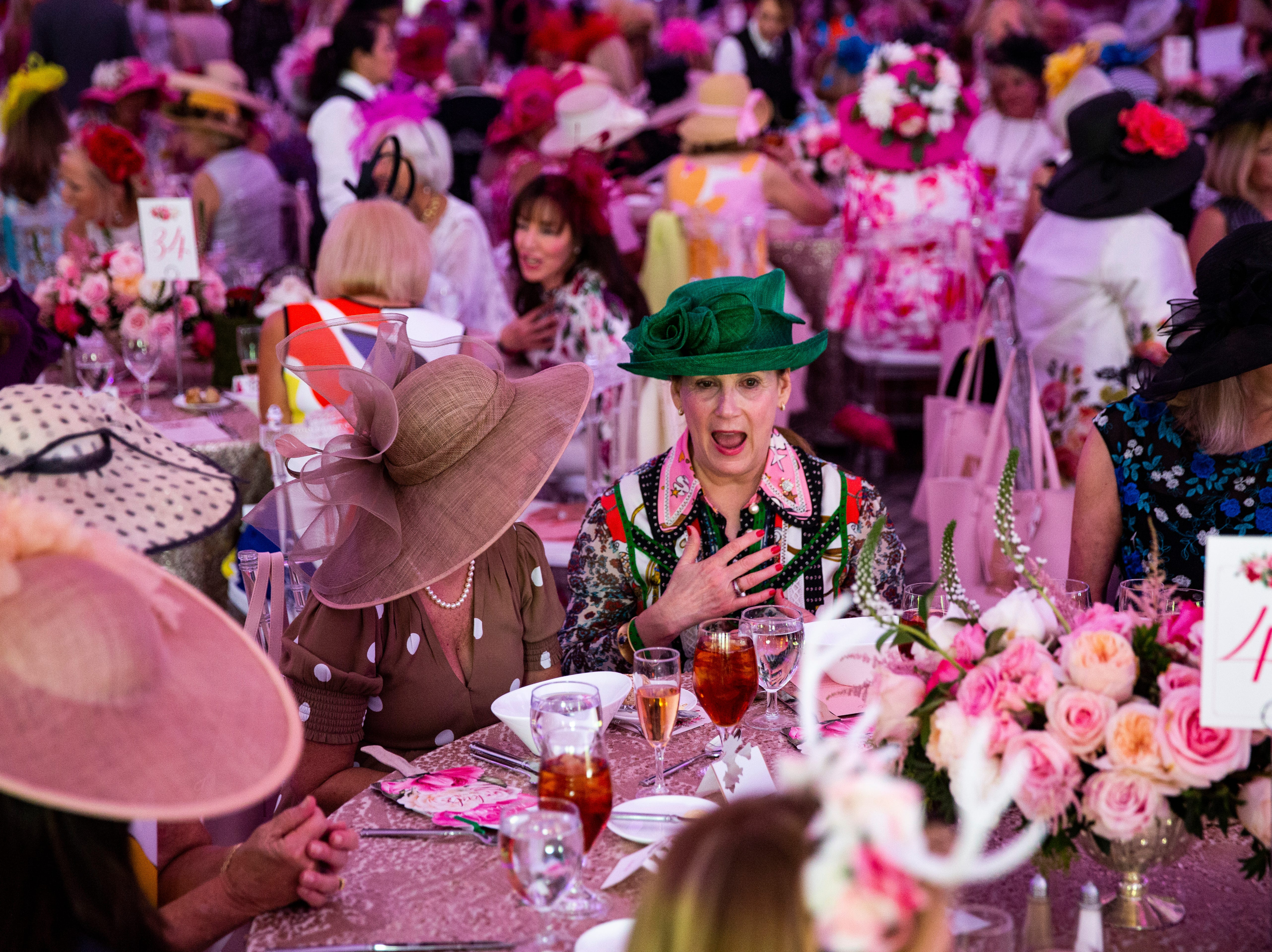 Sharon Kaltenborn of Naples shares a story with a friend during the 15th annual Hats in the Garden fundraiser luncheon at the Naples Botanical Garden on Wednesday, Nov.7, 2018. The fundraiser marks the kickoff to the year's social season. Since the inception of the fundraiser in 2004, the event has been supported by the Sustaining Leadership Council, a group of women who dedicate their time and charitable support to the Botanical Garden's special events and donor programs.