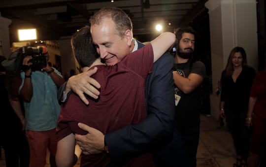 Congressman Mario Diaz-Balart hugs his son Cristian during a victory party at the Flamingo Terrace at Hialeah Park, Tuesday, Nov. 6, 2018, in Hialeah.