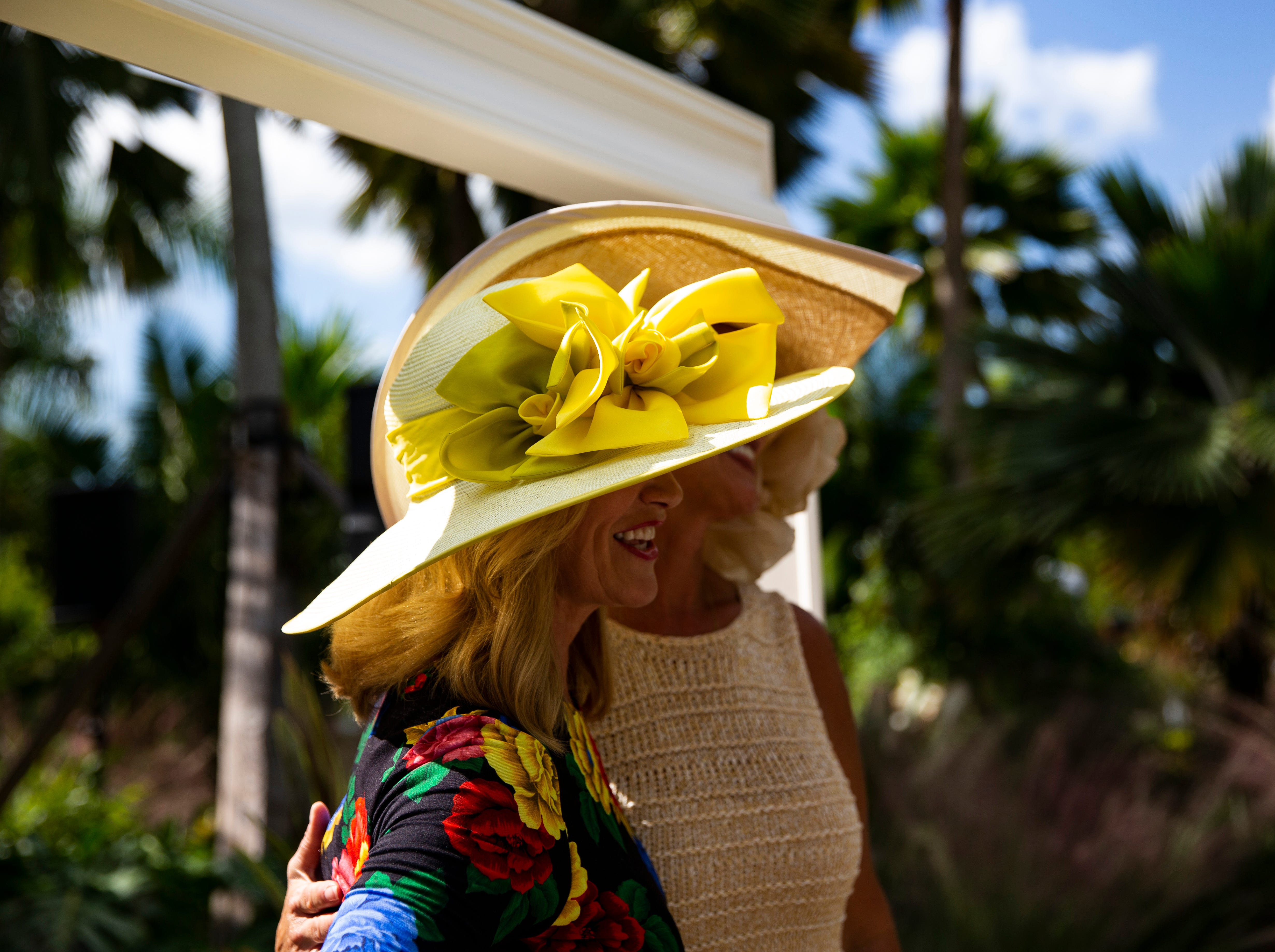 The 15th annual Hats in Garden fundraiser hosted at the Naples Botanical Garden was themed Rubies and Roses, urging the guests to wear clothes and millinery matching the overall theme.