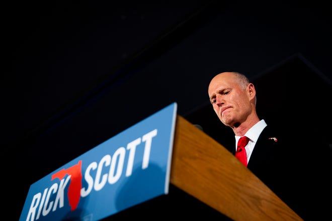 Rick Scott fights back tears as he talks about his late mother during a speech to supporters after declaring victory his senate race on Tuesday, November 6, 2018, at LaPlaya Beach and Golf Resort in Naples.