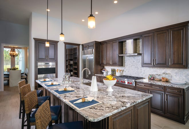 The 3,117-square-foot Aragon at Azure at Hacienda Lakes features a gourmet kitchen, a luxurious master bedroom suite, and a three-car garage.