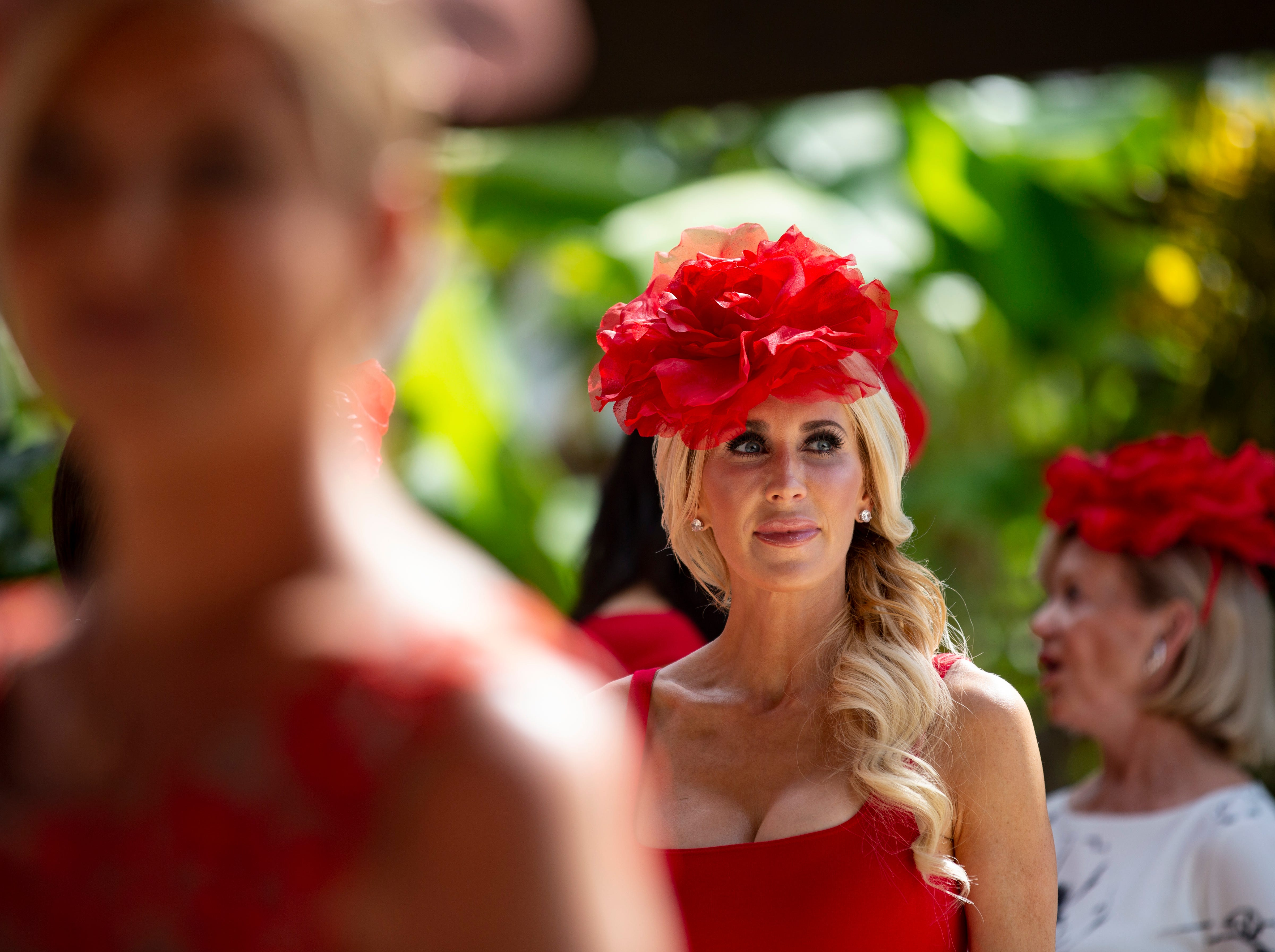 Darby Hills of Chicago attends the 15th annual Hats in the Garden fundraiser in a stunning red millinery, as per the theme of the event - Rubies and Roses on Nov.7, 2018 at the Naples Botanical Garden.