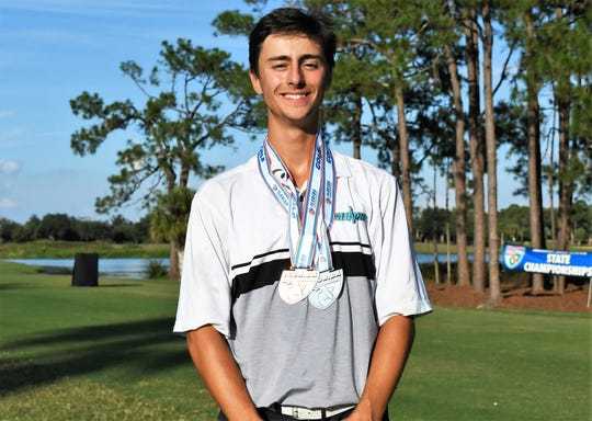 Gulf Coast senior Remi Chartier poses with his medals after helping the Sharks to a second-place finish at the Class 3A state golf tournament and also finishing third overall at the Mission Inn & Resort in Howey-in-the-Hills on Wednesday, Nov. 7, 2018.