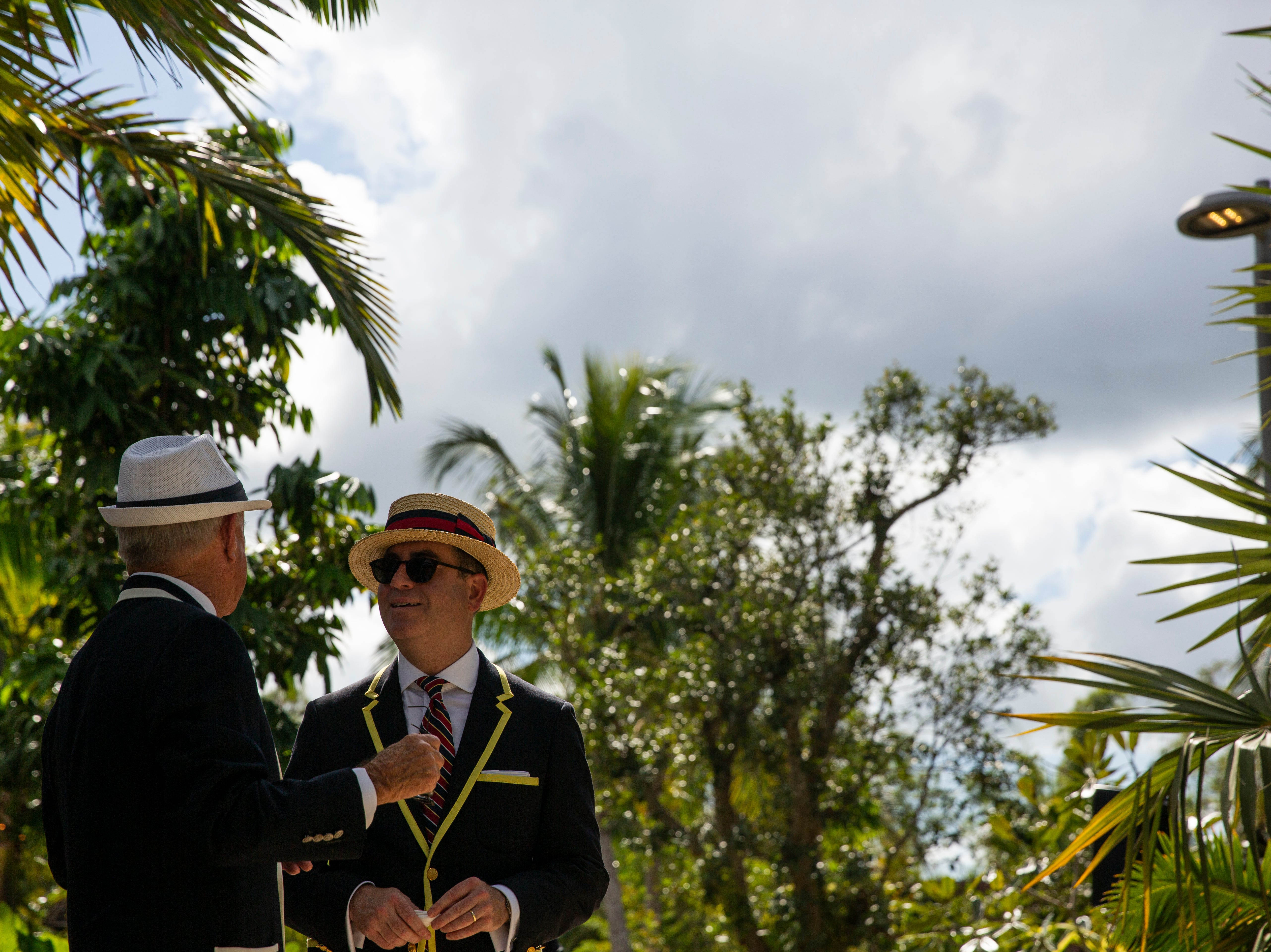 David Bush, a seasonal resident of Palm Beach shares a conversation with Bill Bindley at the 15th annual Hats in the Garden fundraiser at Naples Botanical Garden. Bush said the best part about the event, was its craziness.