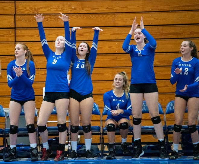 Barron Collier players celebrate a block during the Class 7A regional final match against Port Charlotte at Barron Collier High on Tuesday. The Cougars will play at Stuart-South Fork in the semifinals Saturday.