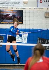 Skylar English of Barron Collier serves the ball during the Class 7A regional final match against Port Charlotte at Barron Collier High on Tuesday, Nov. 6, 2018.