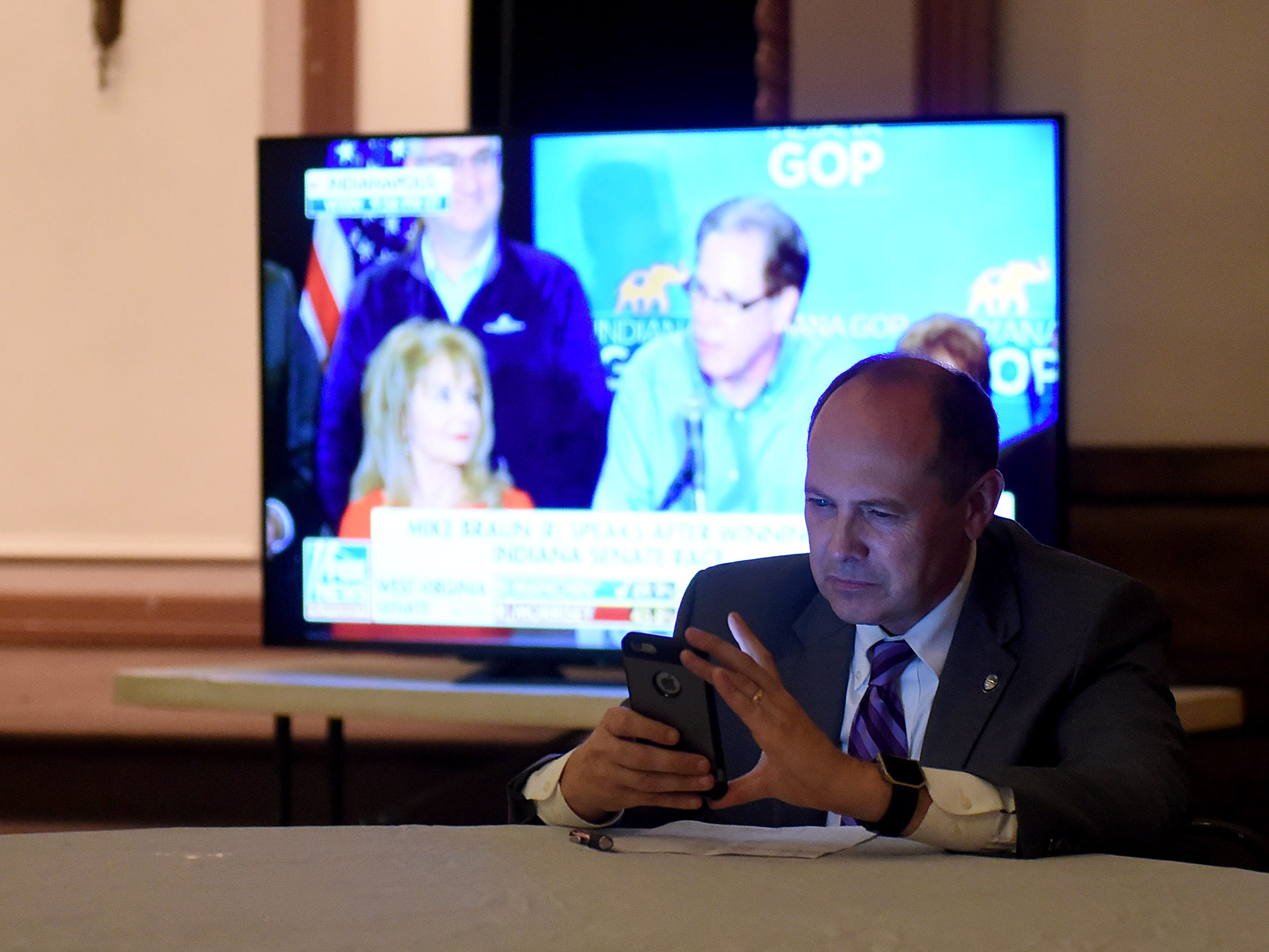Ohio Sen. Jay Hottinger follows election results on his phone after winning his 12th election in his political career on Tuesday, Nov. 6, 2018.