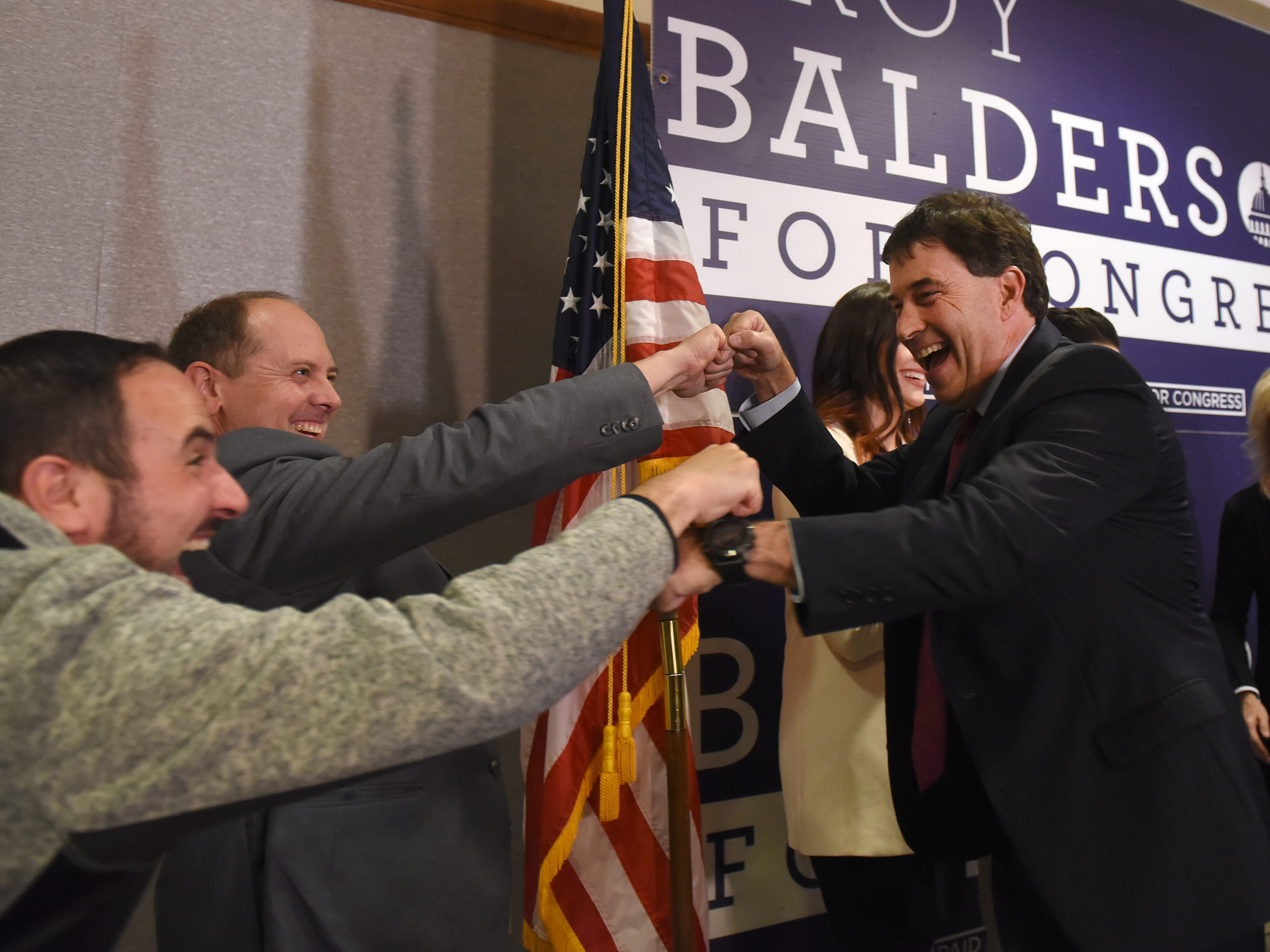 Todd Shelton and Ohio Sen. Jay Hottinger fist bump Congressman Troy Balderson as he leaves the stage after his election night win. Balderson has defeated Democratic challenger Danny O'Connor twice now as the pair faced off in August to fill Pat Tiberi's seat after he retired. Balderson was just one of several Republicans that swept their races, including Brian Hill who easily defeated Kristine Geis in the race for House District 97.