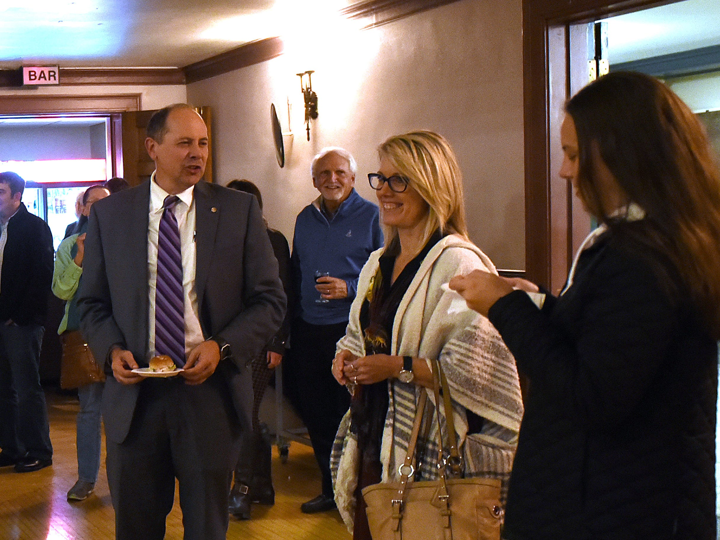 Ohio Sen. Jay Hottinger (left) and daughter, Jayme (right), join local republicans in singing happy birthday to Cheri Hottinger who turned 50 on election night. Jay won his 12th election in his political career on Tuesday, Nov. 6, 2018.