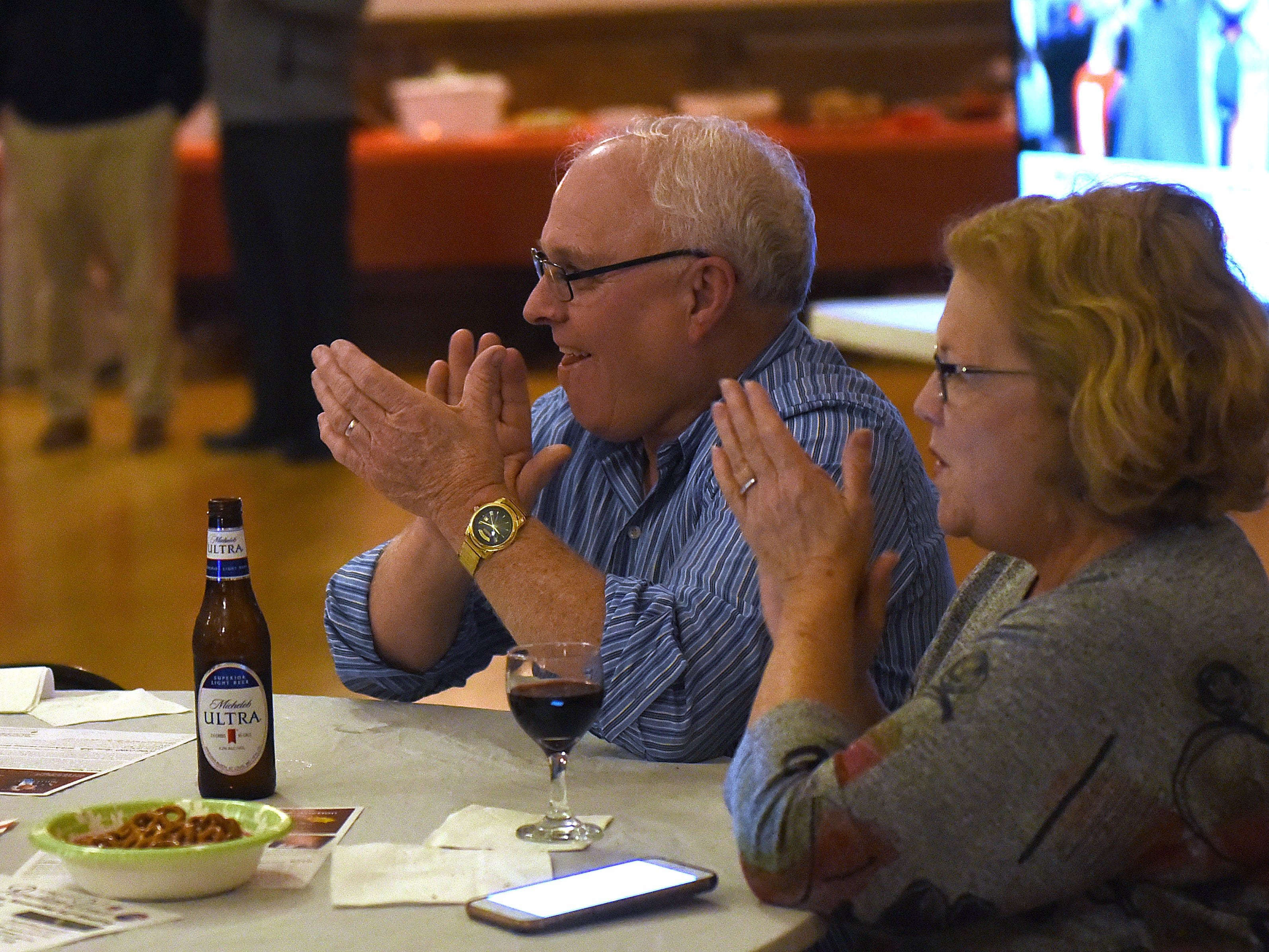 Licking County Commissioner Rick Black and wife Beth Black clap as Rick takes the lead over Adam Rhodes in the commissioners race on Tuesday, Nov. 6, 2018.