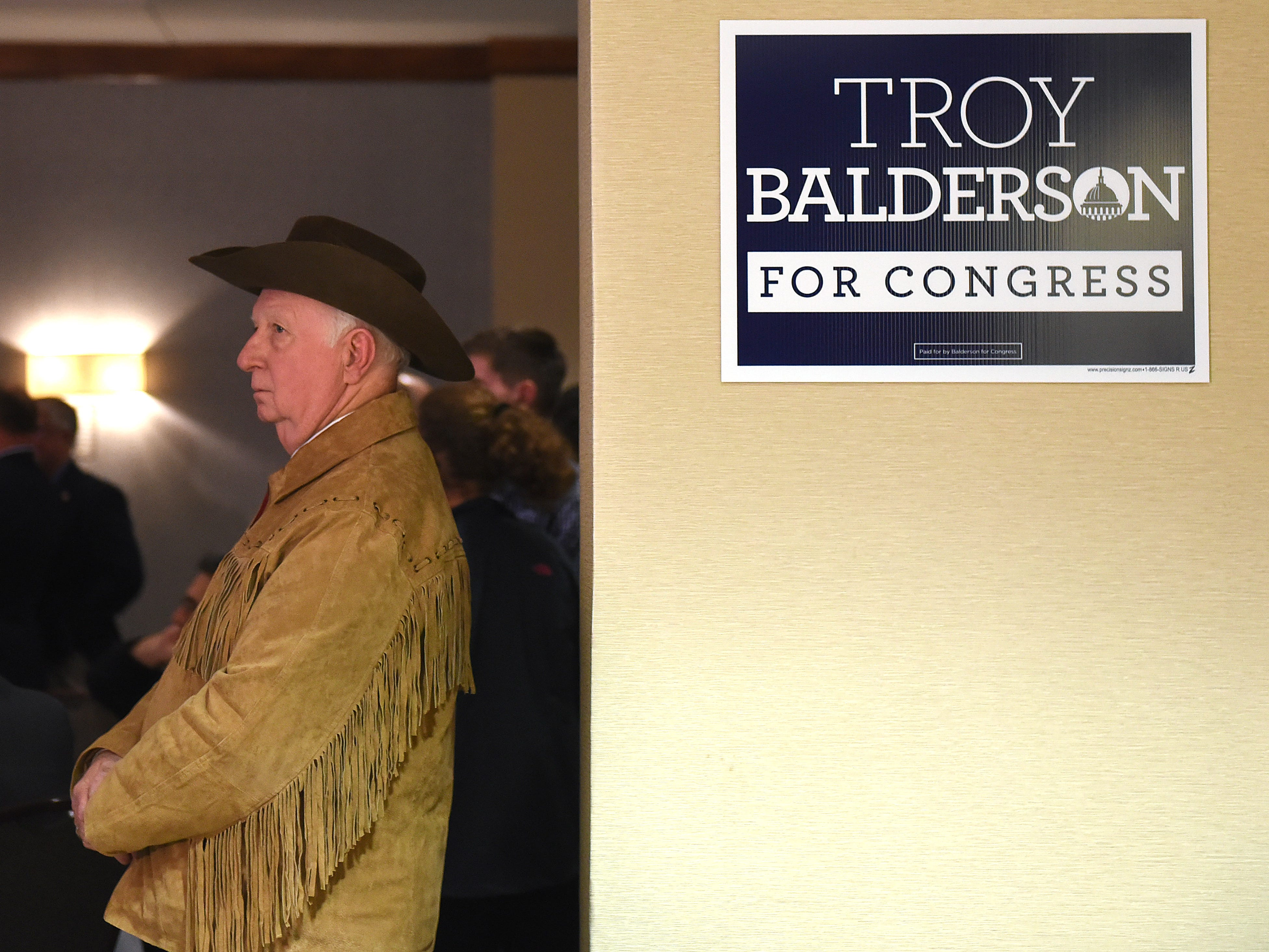 """Life long republican and  """"Trumpite"""" Don W. Traylor, of Newark, watches results during a Troy Balderson election night event on Tuesday, Nov. 6 2018."""