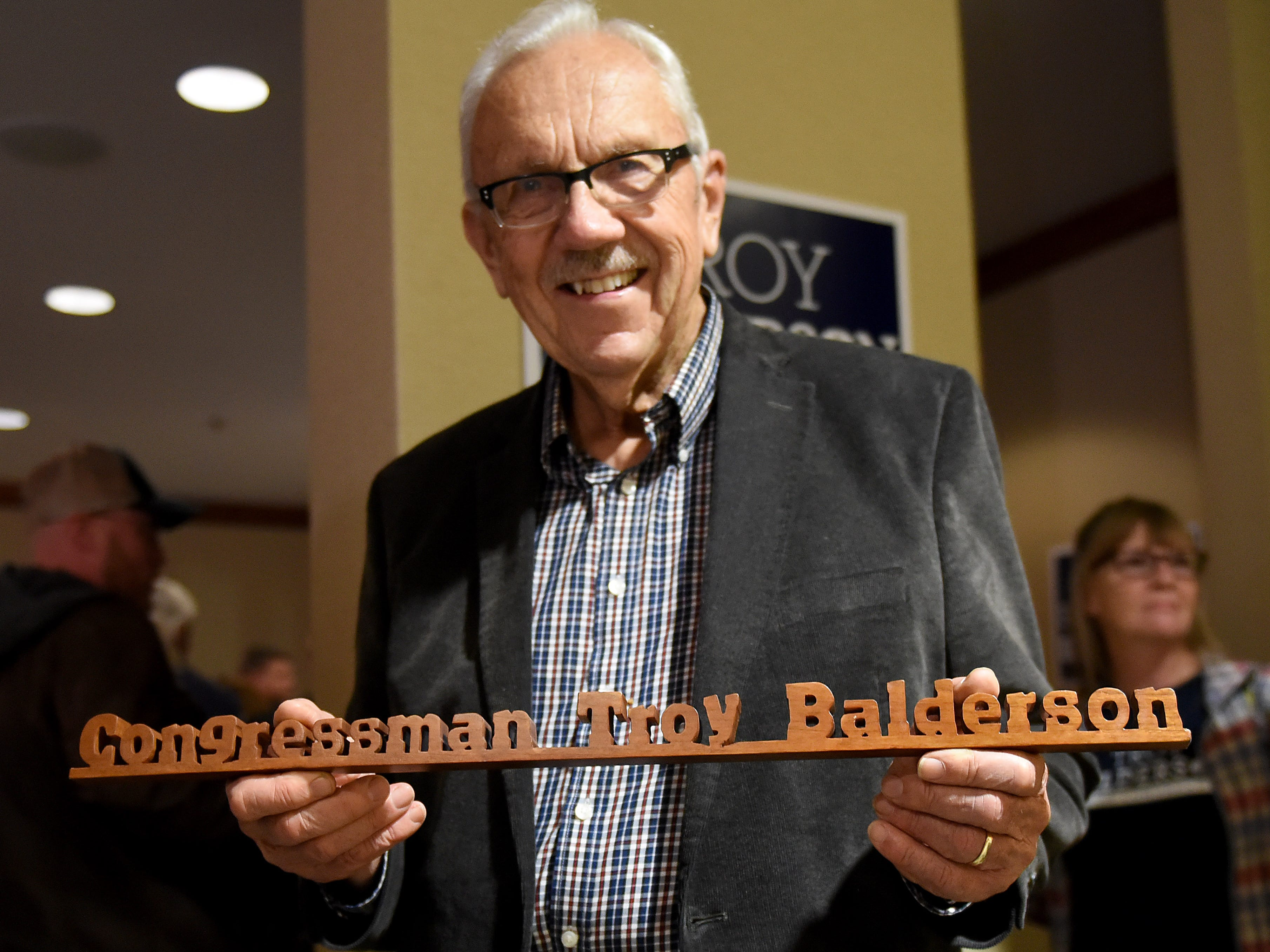 Dave Grube, of St. Albans, with a wooden sign he made for Congressman Troy Balderson during a Balderson election night event at the DoubleTree in Newark. Grube had also made a similar sign for former Ohio 12 Congressman Pat Tiberi.
