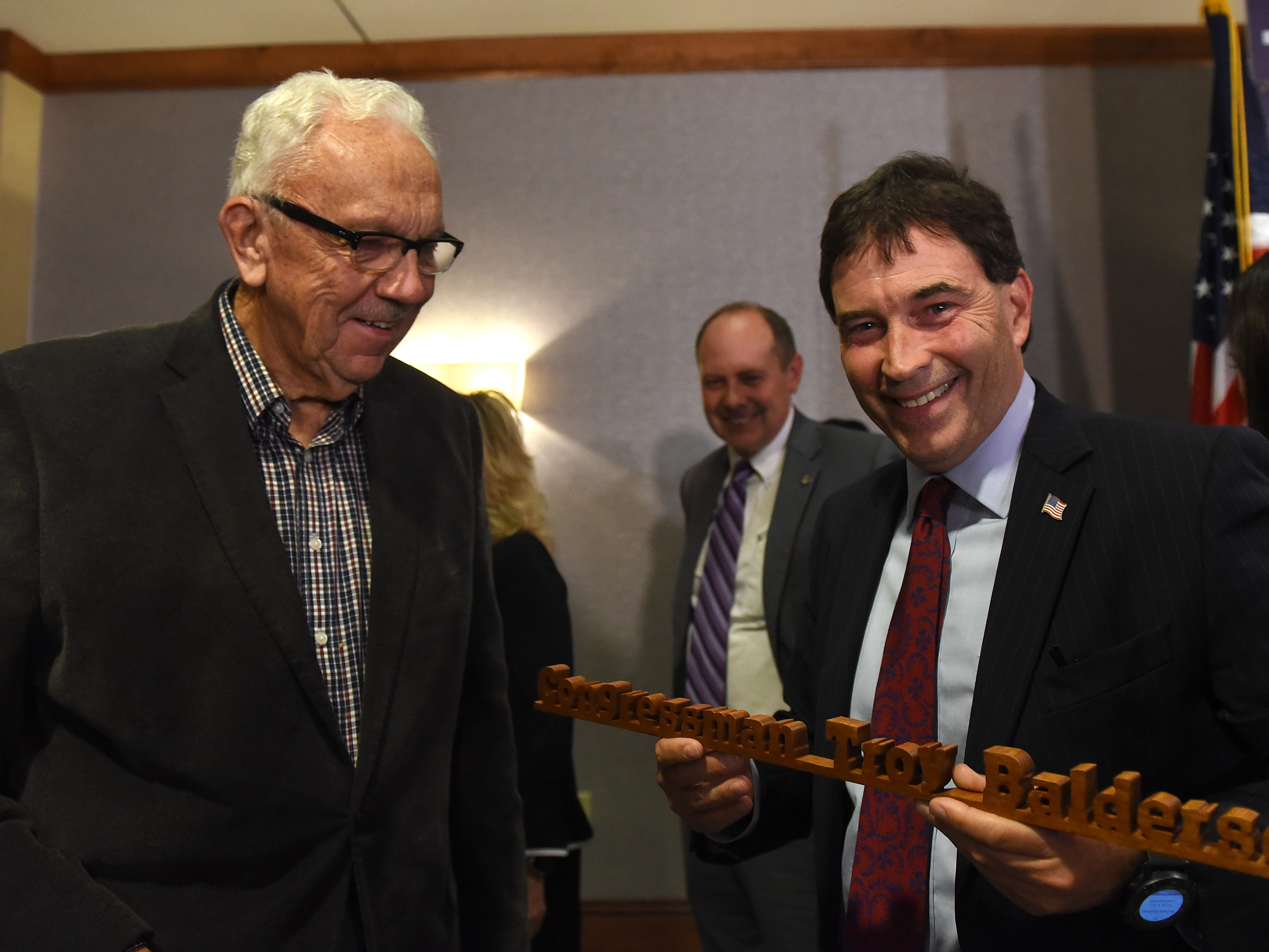 Dave Grube, of St. Albans, presents Congressman Troy Balderson with a wooden sign he made during an election night event at the DoubleTree in Newark. Grube had also made a similar sign for former Ohio 12 Congressman Pat Tiberi.