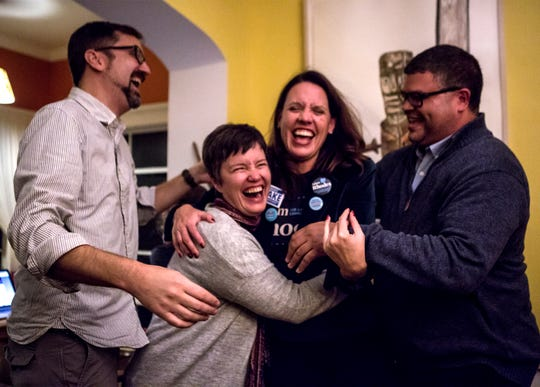 Democratic candidate for Licking County Commissioner, Adam Rhodes, left, Democratic candidate for State Senate, Melinda Miller, campaign manager Michelle Newman, and Democratic candidate for State Representative, Jeremy Blake, laugh after an embrace that came after a heartfelt thank you to all of their supporters. The three candidates lost their bids, but vowed to keep working to make changes in Licking County.