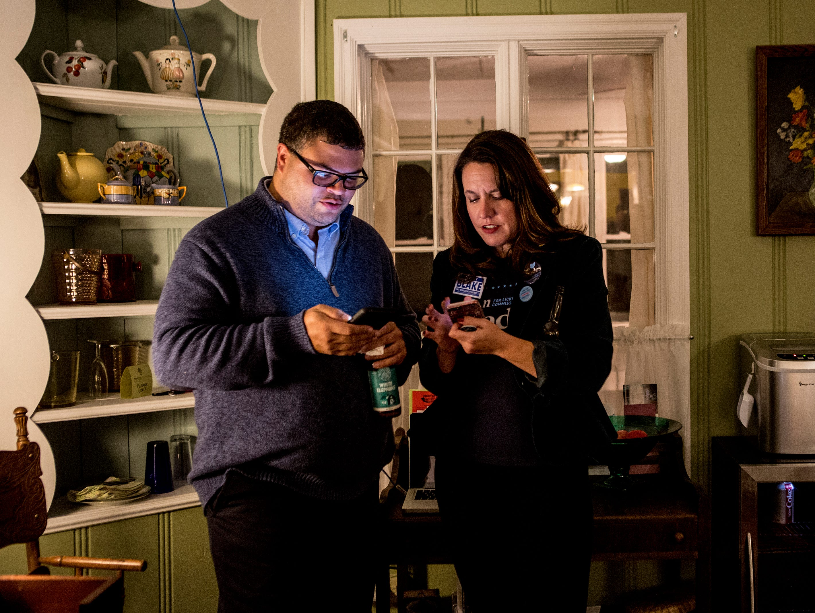 Democratic candidate for state representative, Jeremy Blake, and campaign manger, Michelle Newman, look up local results online during the Democratic election watch party Tuesday evening. Blake lost the election to incumbent Scott Ryan.