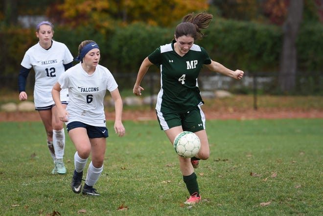 Nicole Passero (no. 4) of Midland Park (in green) runs with the ball as Mia Larsen (no. 6) of Saddle Brook (in white) follows her during the North 1, Group 1 girls soccer semifinal at Midland Park High School on 11/07/18. Midland Park won the game 6 to 1.