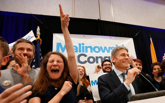 The Democratic candidate for the House of Representatives in District 7, Tom Malinowski, celebrates during an election night watch party, Tuesday, Nov. 6, 2018, in Berkeley Heights, N.J. (AP Photo/Noah K. Murray)