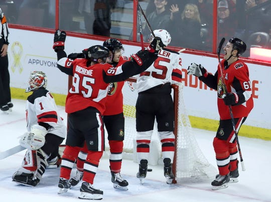 Ottawa Senators' Colin White (36) celebrates his goal against the New Jersey Devils with teammates Matt Duchene (95) and Mark Stone (61) during the second period of an NHL hockey game, Tuesday, Nov. 6, 2018 in Ottawa, Ontario.