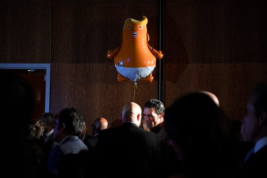 A Baby Trump balloon floats during New Jersey Democratic U.S. Sen. Menendez's election victory party Tuesday, Nov. 6, 2018, in Hoboken.