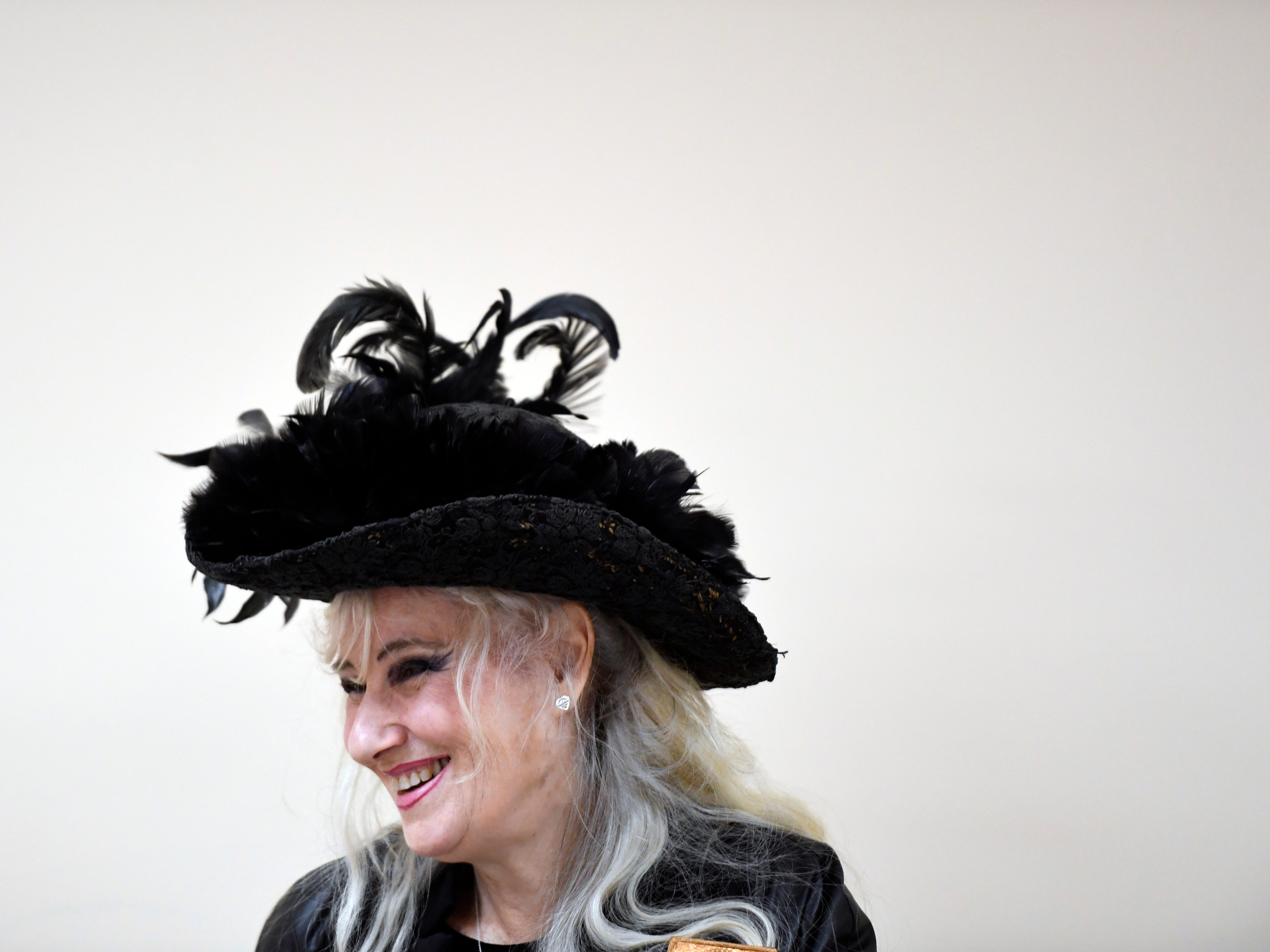 With a black dress, dark stories and jokes, she helps regular people write memoirs
