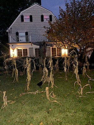 """The """"Amityville Horror"""" house on Halloween, 2018. Ronald DeFeo killed six family members there on Nov. 13, 1974."""