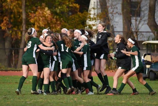 Midland Park players celebrate their victory 6 to 1 over Saddle Brook during the North 1, Group 1 girls soccer semifinal at Midland Park High School on 11/07/18.