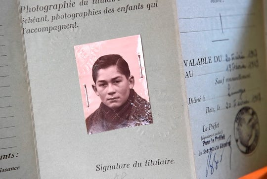 Carl Hausman's passport photo taken when he was 14 years old, before he came to the United States to live with his uncle in Brooklyn.