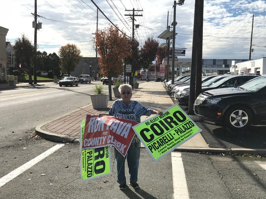 """Louise Capra taking down signs in Totowa on Wednesday. """"It's a back lash against the President,"""" she said of the Republican losses in congress and county races."""