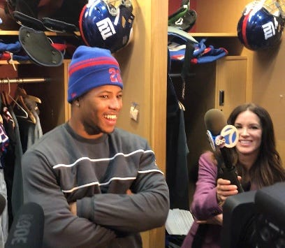 NY Giants rookie running back Saquon Barkley shares a laugh at his locker after practice Tuesday when discussing with reporters his goals for the second half of the season.