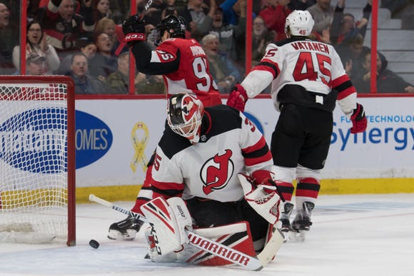 New Jersey Devils goalie Cory Schneider (35) reacts to a goal scored in the second period against the Ottawa Senators at Canadian Tire Centre.