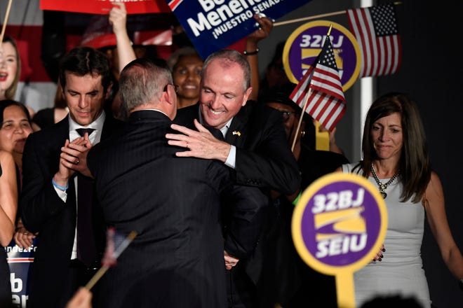 (L-R) Robert Menendez, Jr., Senator Robert Menendez Sr., Governor Phil Murphy, and First Lady Tammy Murphy on stage during Menendez's election victory party on Tuesday, Nov. 6, 2018, in Hoboken.
