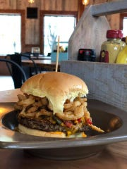 """The Impossible Burger at OMG Burger & Brew comes with frizzled onions, """"boom boom"""" sauce and fire roasted corn salsa!"""