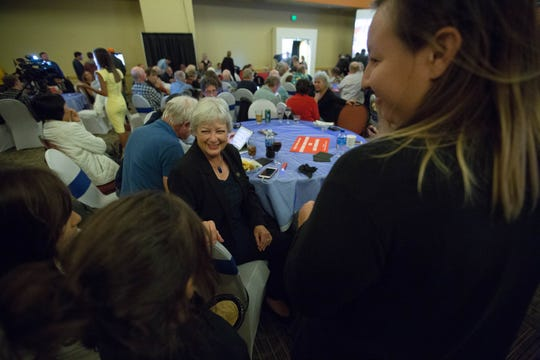Joanne Ferrary, speaks to Sasha Lujan, right, and her daughters Marisol Lujan, 9, center, and Nalani Lujan, 8, left, at a Democratic watch party being held at the Las Cruces Convention Center Tuesday, Nov. 6, 2018.