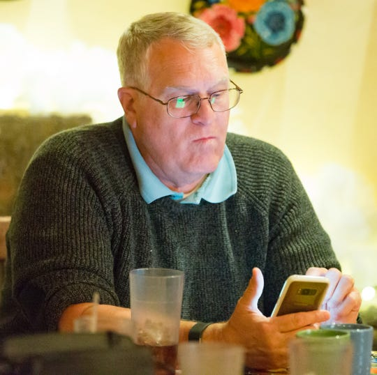 State Rep. District 36 candidate David Tofsted, Republican, watches election results from his phone on Tuesday, Nov. 6, 2018, during a GOP election watch party at La Posta restaurant in Mesilla.