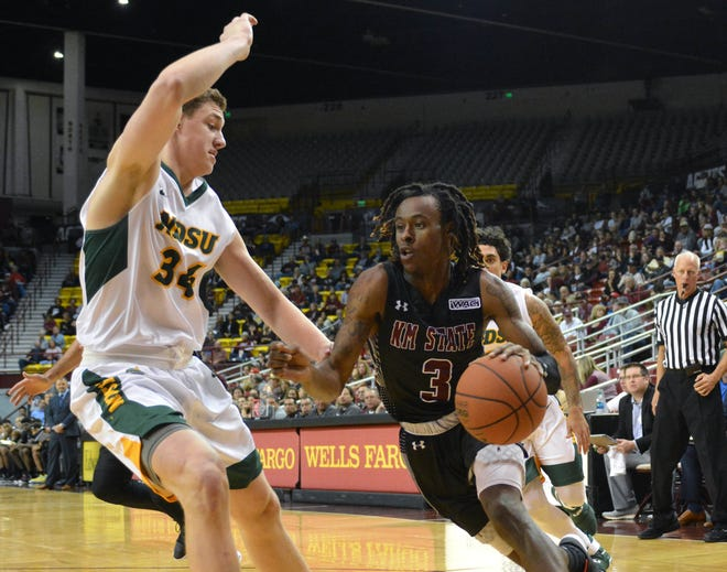 New Mexico State's Terrell Brown drives the baseline looking to pass the ball off to a teammate against North Dakota State Tuesday night at the Pan American Center.
