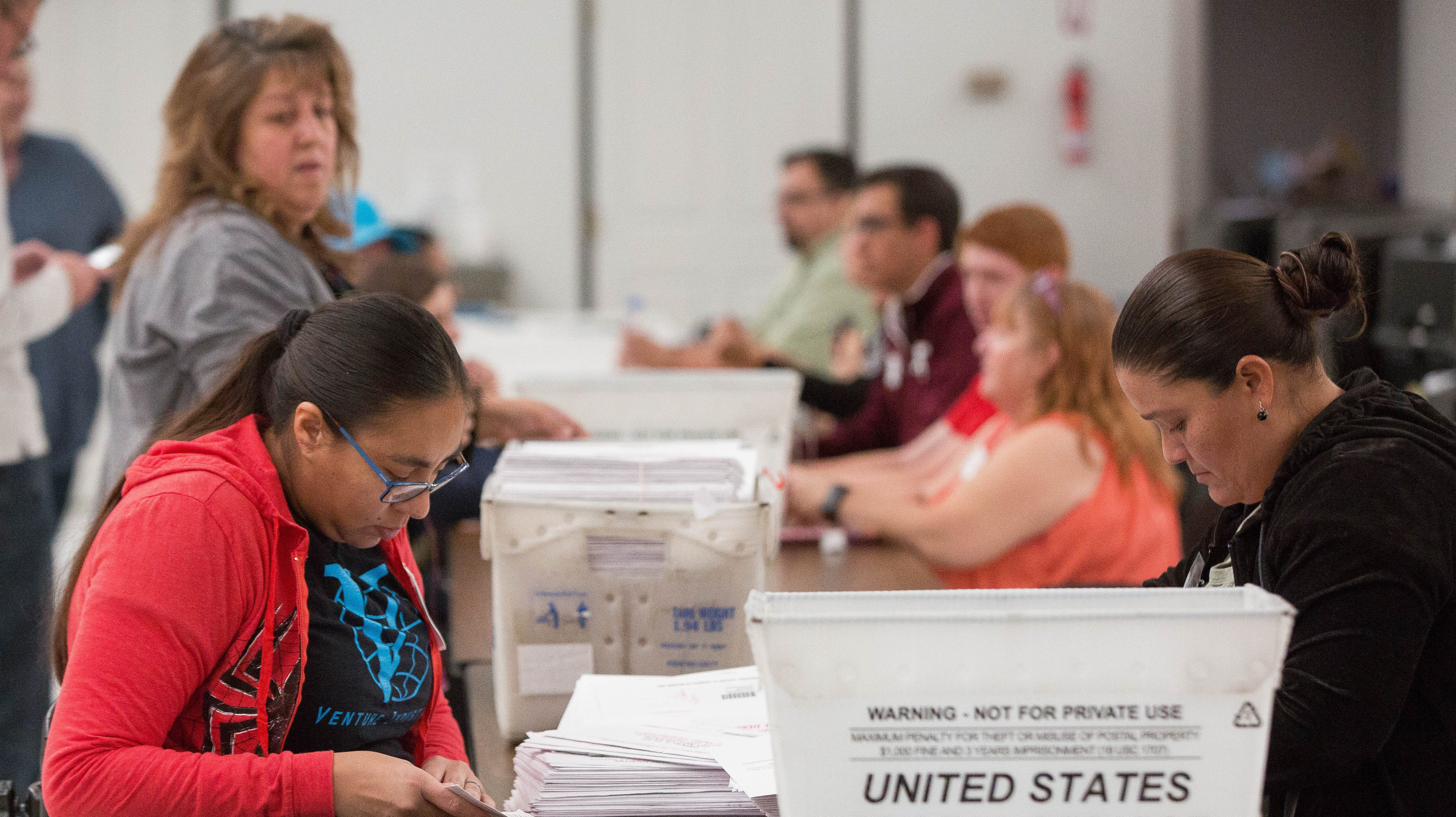 Seventeen poll workers scan, qualify and count 4,000 absentee ballots on Wednesday, Nov. 7, 2018, at the Doña Ana County Bureau of Elections Warehouse. The ballots are those remaining from a pool of more than 8,000 that have yet to be factored into Doña Ana County's overall election results.