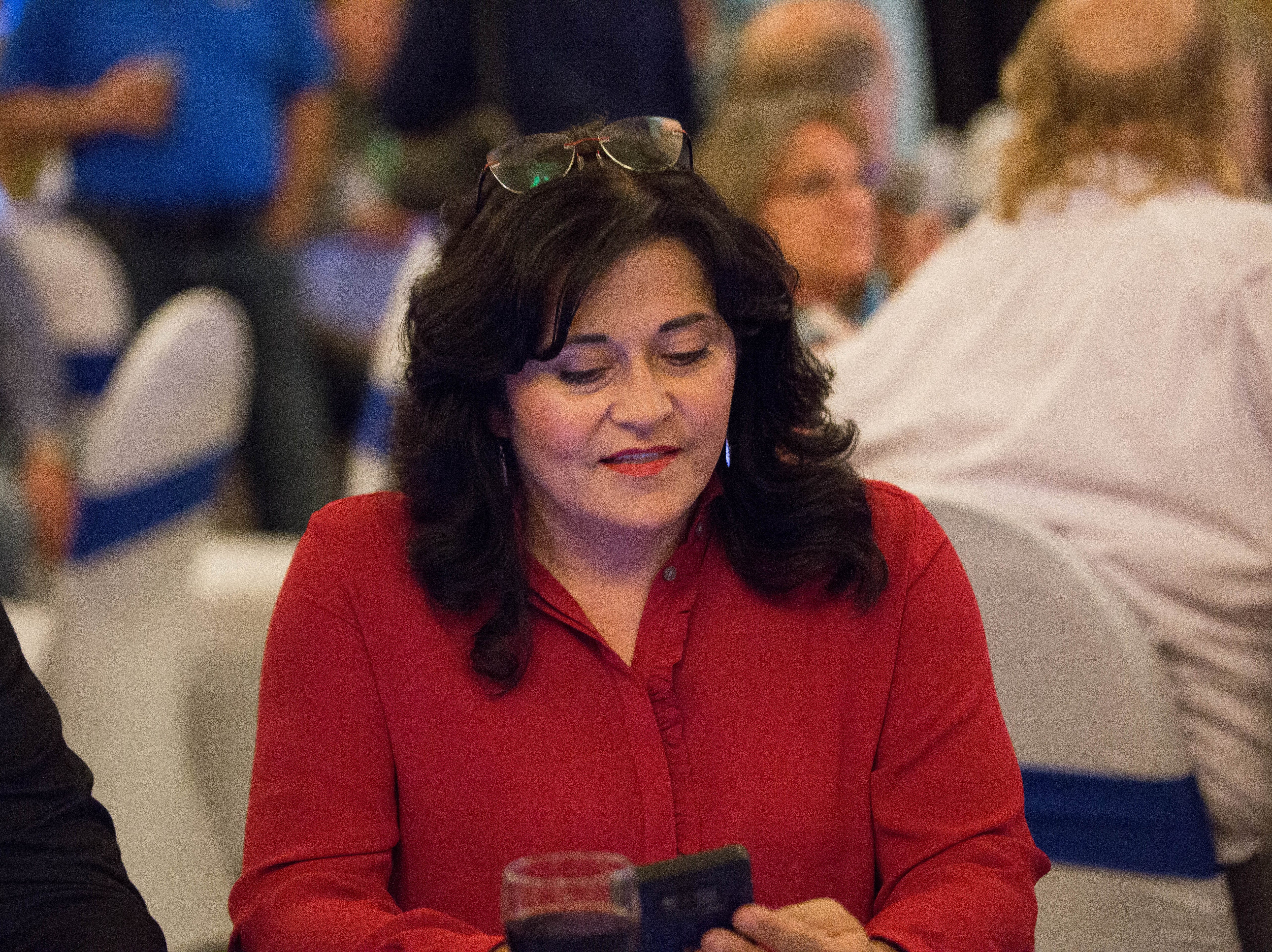 Karen Trujillo, democratic candidate for Doña Ana County Commission district 5, checks her phone for election results, Tuesday November 6, 2018 at a Democratic watch party being held at the Las Cruces Convention Center.