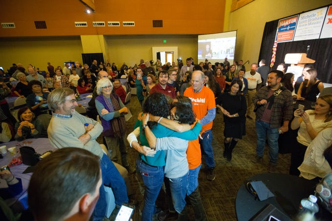 Xochitl Torres Small, enters the democratic watch party at the Las Cruces Convention Center, being surrounded by supporters and receiving cheers and hugs, Torres Smalls said she wouldn't be making any speeches until all the numbers were in, Tuesday November 6, 2018..