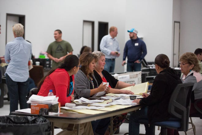 Poll workers tally by hand overseas ballots, Wednesday November 7, 2018 at the Doña Ana County Bureau of elections Warehouse.