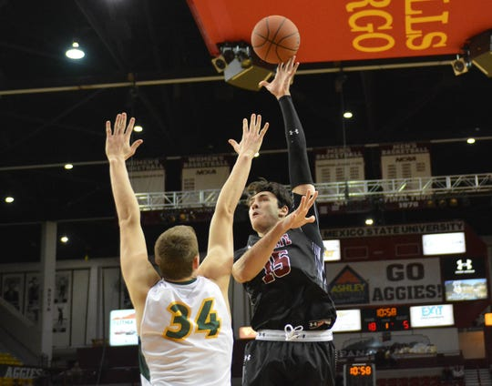New Mexico State newcomer Ivan Aurrecoechea goes up with his left hand for a score against North Dakota State on Tuesday night.