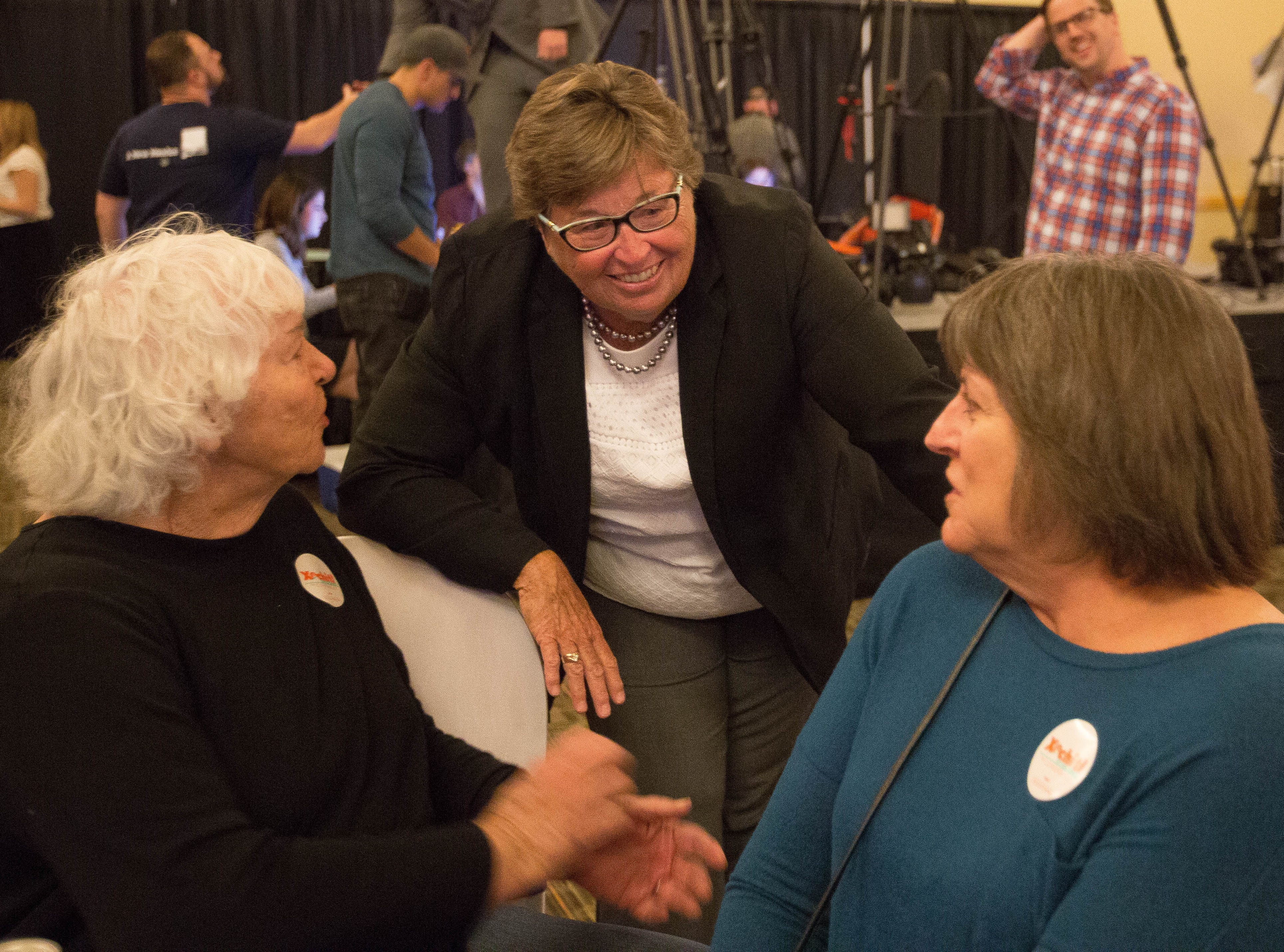 Kim Stewart, Democratic candidate for sheriff of Doña Ana County, talks with supporters Joan Keif, left, and Beverly Stotz, right, at the Las Cruces Convention Center during a Democratic Party watch party held Tuesday, Nov. 6, 2018.