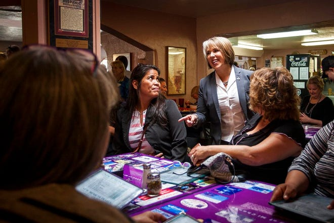 New Mexico Democratic gubernatorial candidate Michelle Lujan Grisham speaks to constituents at Barelas Coffee House restaurant in Albuquerque, N.M., on midterms election day Tuesday, Nov. 6, 2018.