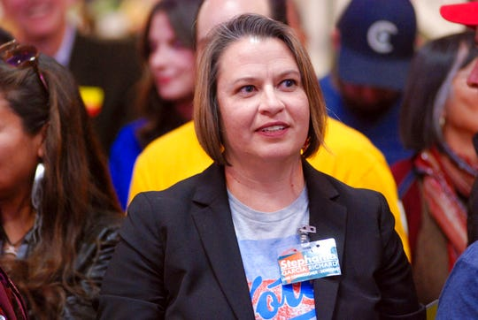 In this Thursday, Oct. 25, 2018 photo, Stephanie Garcia Richard campaigns for state land commissioner at a Democratic political rally in Santa Fe, N.M.