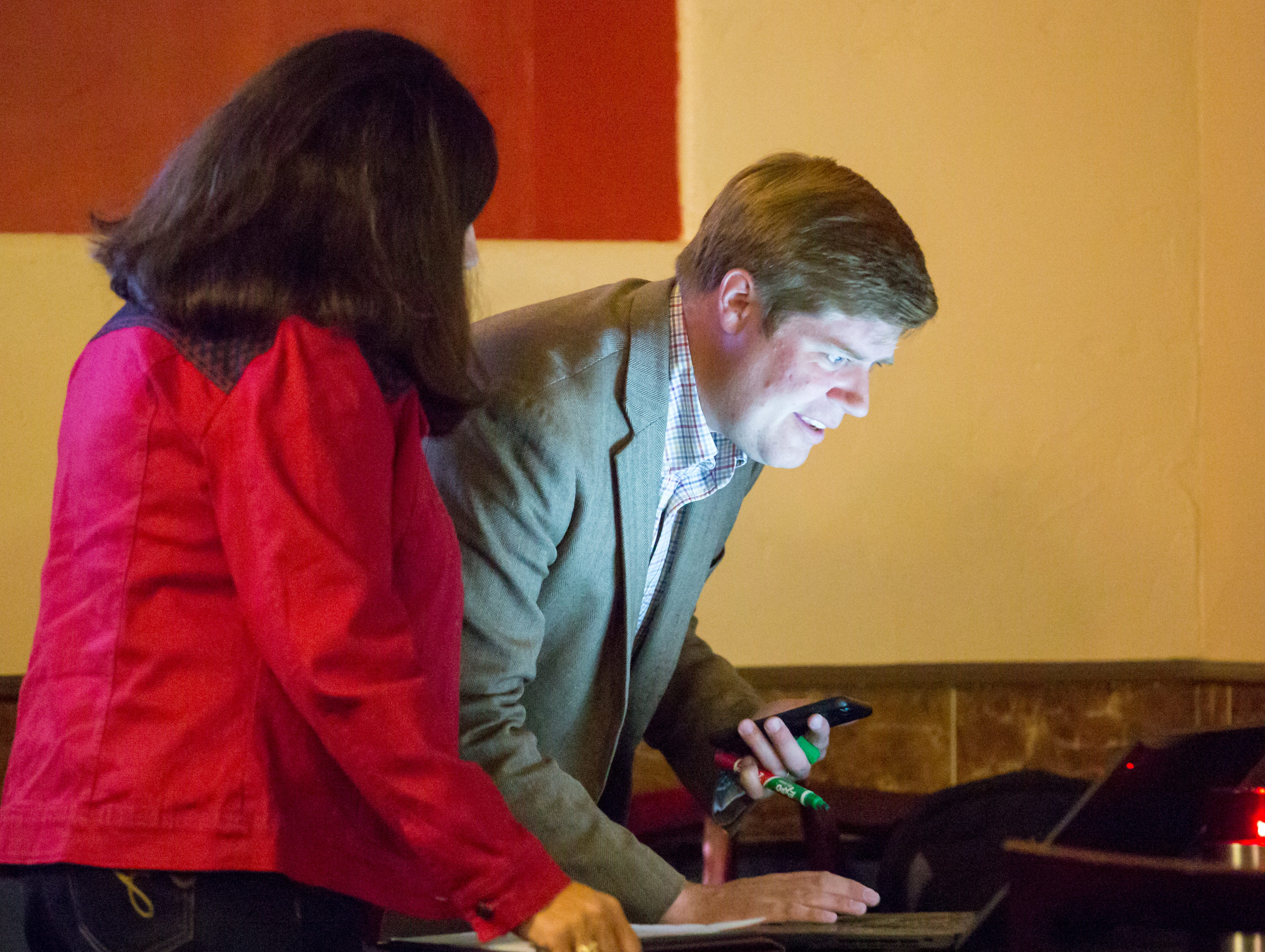 Incumbent District 3 Doña Ana County Commissioner Benjamin L. Rawson looks at polling projections during his election watch party at the Sunset Grill in Las Cruces on Tuesday, Nov. 6, 2018 during the mid-term election.