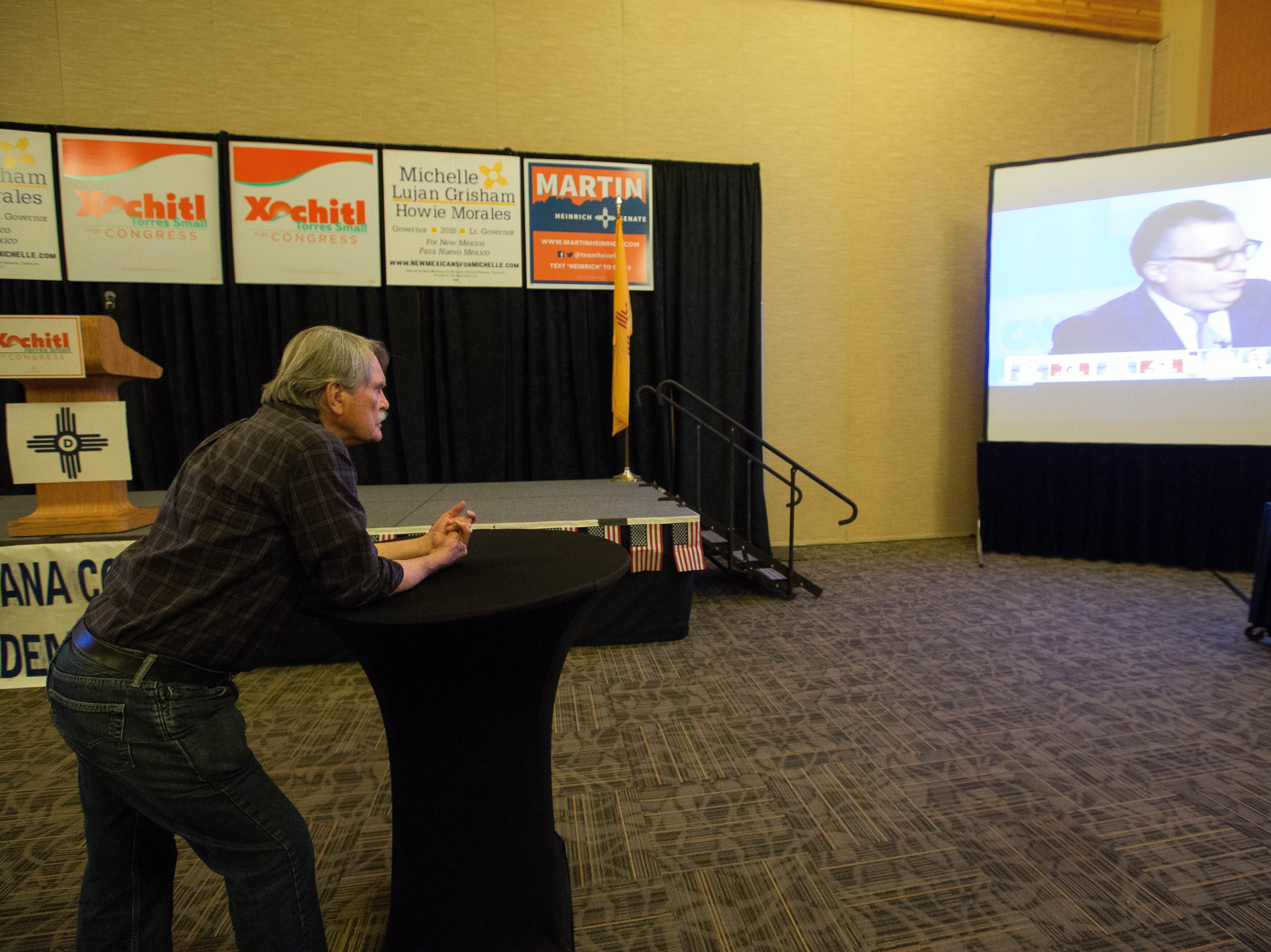 Charlie Donaldson, a volunteer for Xochitl Torres Small from Brooklyn, Ny, watches results come in at a democratic watch party being held at the Las Cruces Convention Center, Tuesday November 6, 2018.