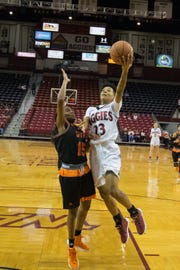 New Mexico State's Aaliyah Prince drives for a lay up against UT Permian Basin on Tuesday at the Pan American Center.